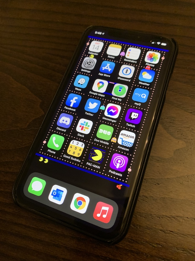 Photo of my iPhone XR with the Pac-Man wallpaper